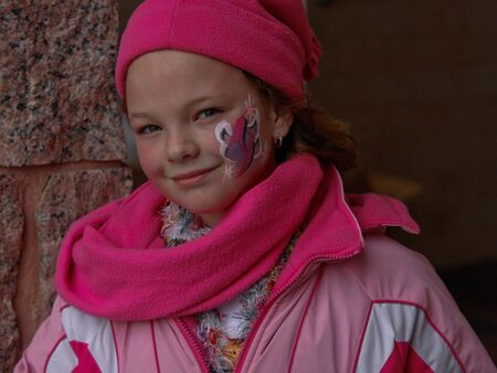 pink hat: Young girl in pink hat, coat and scarf. Stock Photo