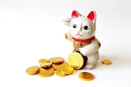 gato, dinheiro, boneca de gato e moeda de ouro Imagens