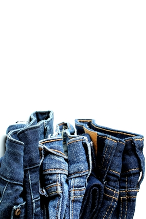 walk in closet: jean long trouser folding on white background and copy space