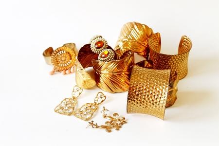 golden: golden bracelet on white background