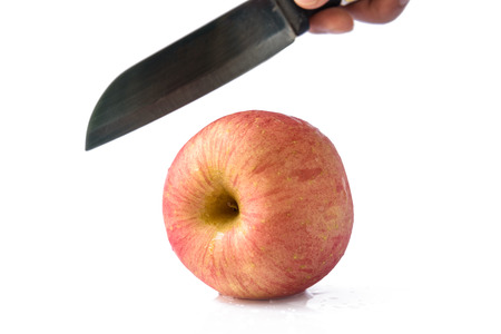 Fuji apple with knife Isolated on white background. Stock Photo