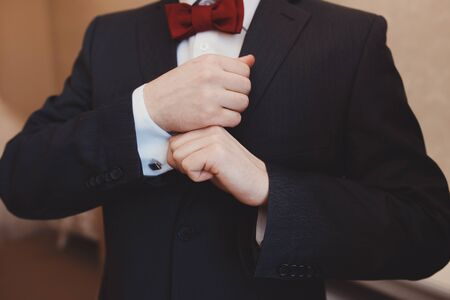 cuffs: The groom adjusts his cuffs Stock Photo