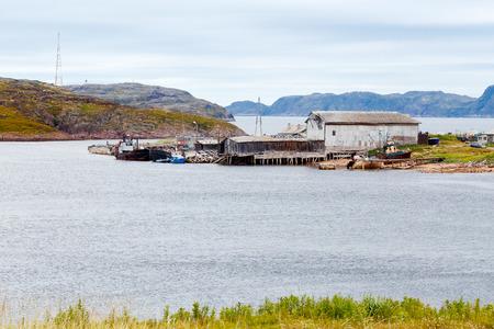 corpses: Teriberka, Kola Peninsula, Shore with parked fishermens ships, some of the corpses sank.