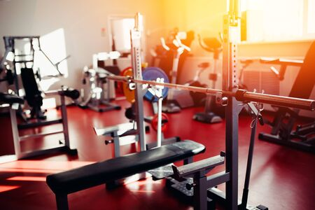 Sports equipment dumbbell rests in a row in gym Stock Photo
