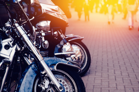 chrome man: Motorcycle luxury items close-up: headlights, shock absorber, wheel, wing, toning. Concept travel on two wheels. Stock Photo