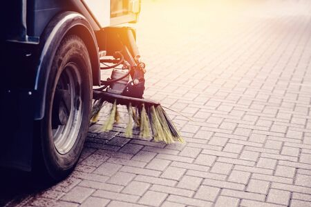 Close-up street sweeper machine cleaning the streets. Concept clean streets from debris. Reklamní fotografie