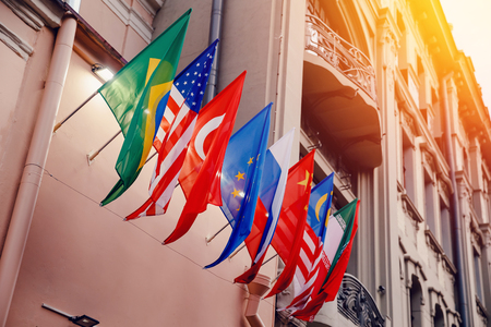 Flags of russia, united states, brazil, turkey, china, european union, iran on embassy house Stock Photo