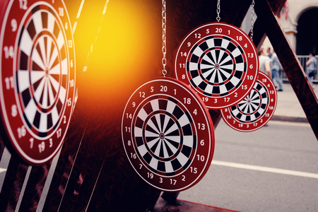 Targets for dartboard dartboard on a dark background. Concept is the choice of purpose. Stock Photo