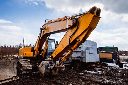 Excavators machine and bulldozer loader in construction site on sky background. Concept machines for construction. Stock Photo