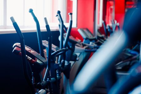Bicycle simulator, sports equipment in the gym. Stock Photo