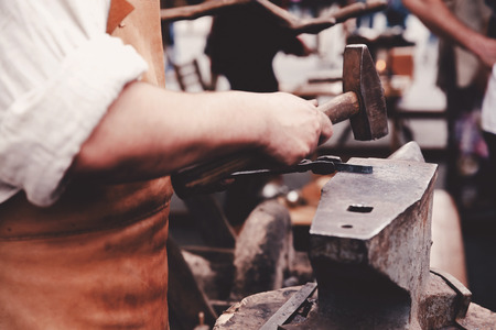 forge: Blacksmiths work as forging forging on metal. The concept of making products from iron.