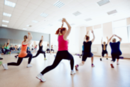 Blurred background of people group of girls playing in yoga and fitness,crossfit in the gym. Stock Photo