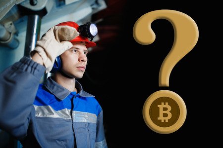 male miner on a dark background in a mine with a question mark and bitcoin. The concept of extraction of crypto currency, digging, mining. copyspace