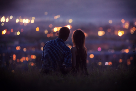 Lovers man and girl against background night city, night starry sky and horizon. Concept date Valentines Day, first kiss love, forever together.