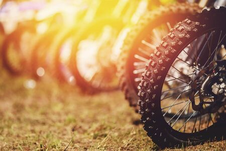 close-up wheel of an off-road motorcycle for a motocross through the mud. copyspace
