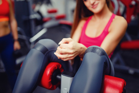 Close-up of the girls hand, which pumps the press in the gym. The concept of doing sports, copyspace Stock Photo
