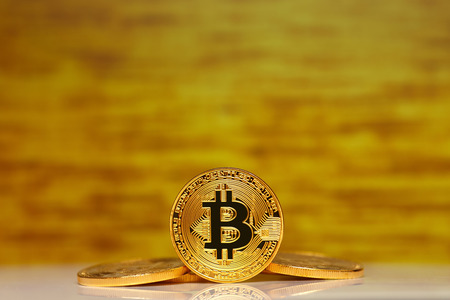 Gold Bitcoin on the gold background. Concept mining