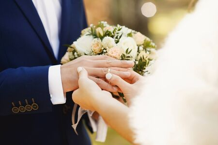 fiancee: Marry me. Bride and grooms hands with wedding rings Stock Photo