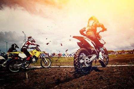 Motorcycle. Team athletes on mountain bike motorcycles on motocross start 版權商用圖片