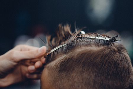full length mirror: Barbershop. Close-up of a mans haircut, hair clips Stock Photo