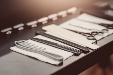 hairdressers tools: combs, razors, scissors, clip-on hair clipper