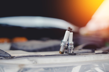 Spark plugs close-up. Concept car check in the car workshop