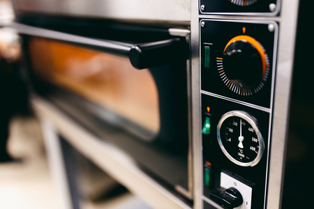 Close-up of an electric oven for pizza making. Concept cafe, restaurant Stock Photo