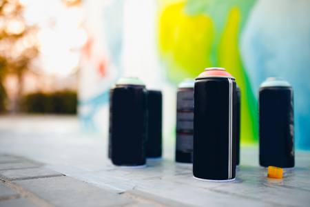 Close-up of cylinders, bank with paint stand in a row. concept of graffiti Stock Photo