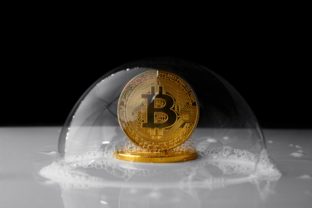 Bitcoin in a soap bubble on black background 写真素材