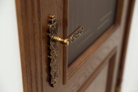 Closeup handle. Modern door handle, tilt view.
