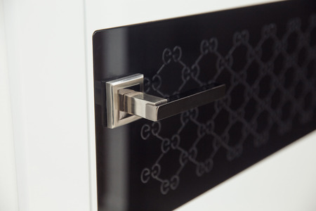 Closeup handle. Modern door handle, tilt view.