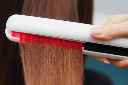 Keratin recovery hair and protein treatment pile with professional ultrasonic iron tool. Concept straighten hair 写真素材