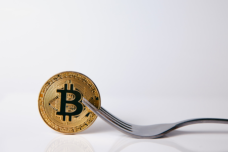 Bitcoin. Golden bitcoin with fork on white background, isolate