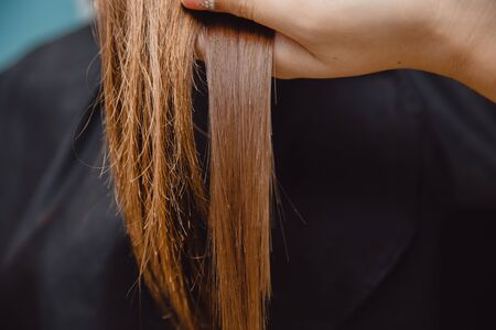 Comparison of healthy and broken, sick hair in a girl.