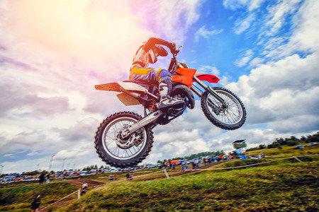 Dirtbike. Dirt bike extreme jump on motocross sunset Stock Photo