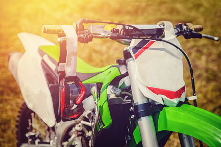 Motocross. Dirtbike, goggles against dirt, motorcycle steering Stock Photo