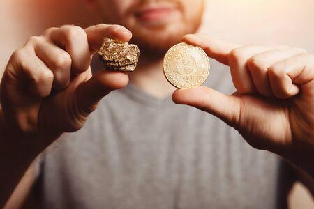 Bitcoin. Man bites a gold coin with his teeth