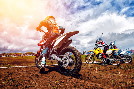 Dirtbike. Bikers is start motocross extreme sunset dirt bike. Stock Photo