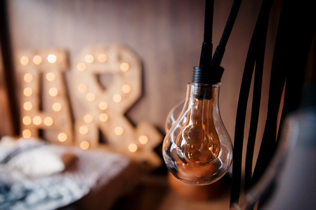 edison lamp. Incandescent lamp built-in wooden letters, loft style Stock Photo