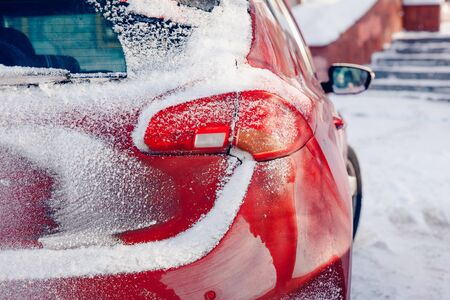 Winter car. Car in snow after storm and cyclone. Snow congestion. Concept cleaning machine in winter. Standard-Bild