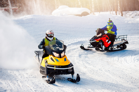 Snowmobile. Snowmobile races in the snow. Concept winter sports, racers. Reklamní fotografie