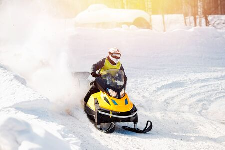 Snowmobile. Snowmobile races in the snow. Concept winter sports, racers. 스톡 콘텐츠