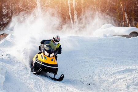 Snowmobile. Snowmobile races in the snow. Concept winter sports, racers. Stock Photo