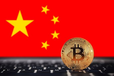 Gold Bitcoin on background of chart China flag.