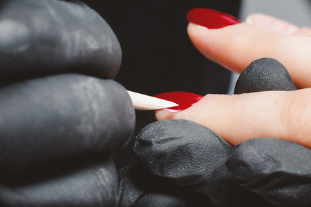 Manicure master applies gel to woman feet in beauty salon. Stock Photo