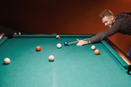 Balls for billiards snooker are triangle, man smashes cue Stock Photo