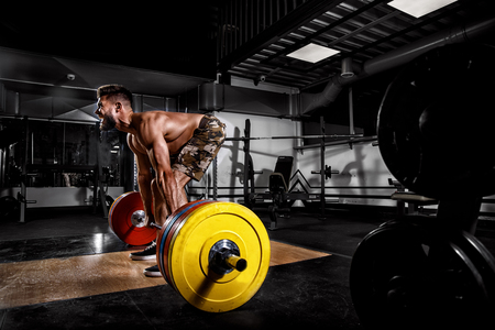 Athlete man motivates screaming before training barbells exercise gym. Concept workout, weight Stock Photo