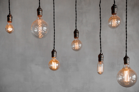 edison retro lamp incandescent bulbs on gray plaster wall background