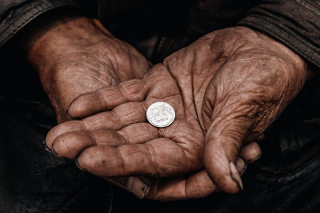 Concept poverty in Russia, people of CIS, USSR. Old hands hold ruble