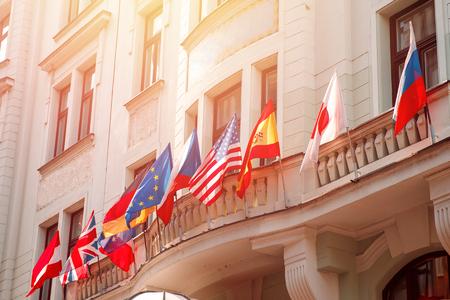 Flags of russia, united states, european union, USA, japan, england, czech republic, Germany on embassy house Standard-Bild